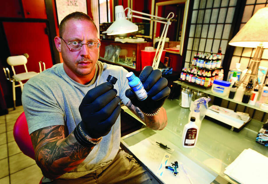Hour photo / Erik Trautmann Josh Glasser, owner of Inkside Out Tattoo parlor responds to fears surrounding an FDArecall of specific contaminated tattoo inks, needles, and kits sold over internet.