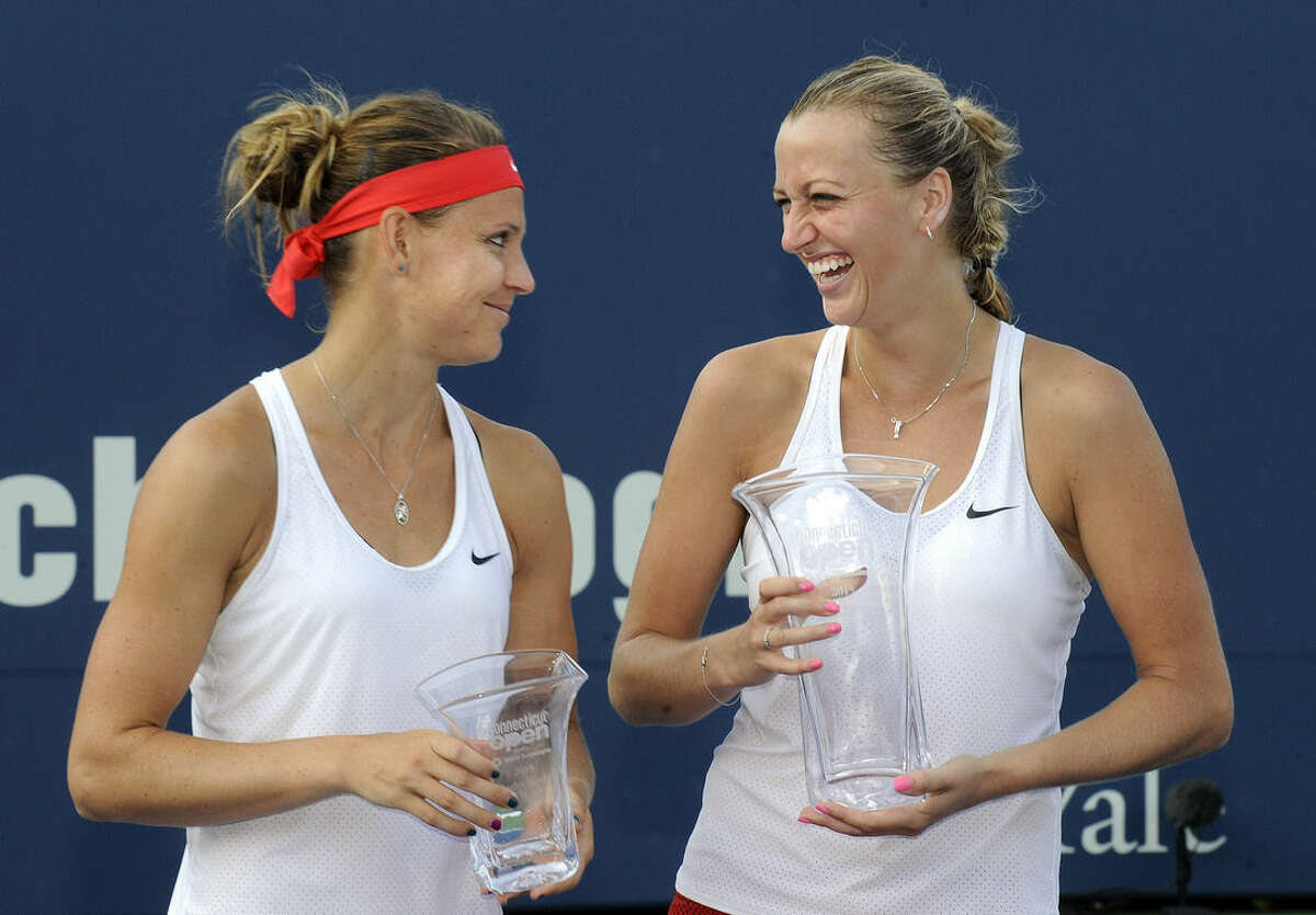 Petra Kvitova, of the Czech Republic, celebrates with fellow Czech Lucie Safarova after Kvitova defeated Safarova 6-7(6), 6-2, 6-2 in the final match of the Connecticut Open tennis tournament in New Haven, Conn., on Saturday, Aug. 29, 2015. (AP Photo/Fred Beckham)