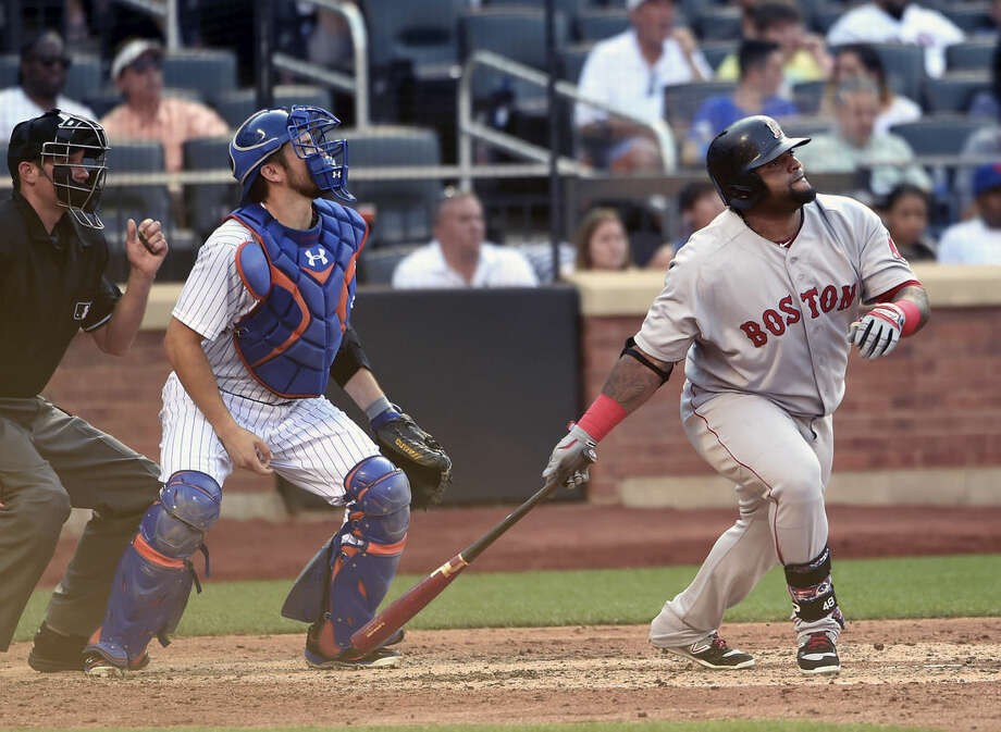New York Mets catcher Travis d'Arnaud and Boston Red Sox's Pablo Sandoval watch Sandoval's RBI double off of Mets starting pitcher Jacob deGrom in the sixth inning of a baseball game at Citi Field on Saturday, Aug. 29, 2015, in New York. (AP Photo/Kathy Kmonicek)
