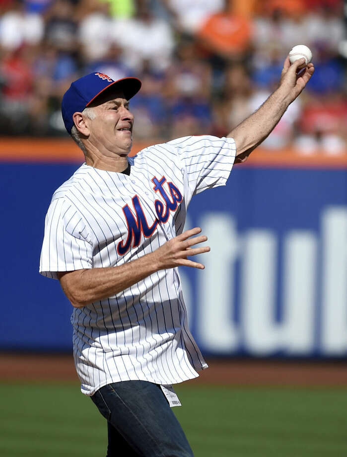 Former professional tennis player John McEnroe throws out the first ceremonial pitch before a baseball game between the New York Mets and the Boston Red Sox at Citi Field on Saturday, Aug. 29, 2015, in New York. (AP Photo/Kathy Kmonicek)