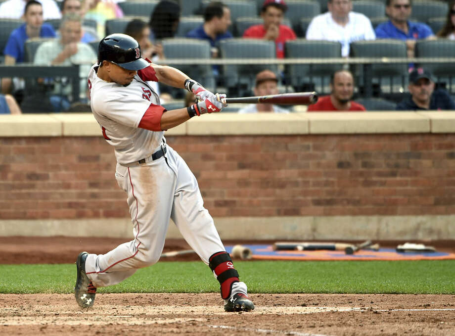 Boston Red Sox' Mookie Betts hits a solo home run off New York Mets relief pitcher Hansel Robles in the seventh inning of a baseball game at Citi Field on Saturday, Aug. 29, 2015, in New York. (AP Photo/Kathy Kmonicek)
