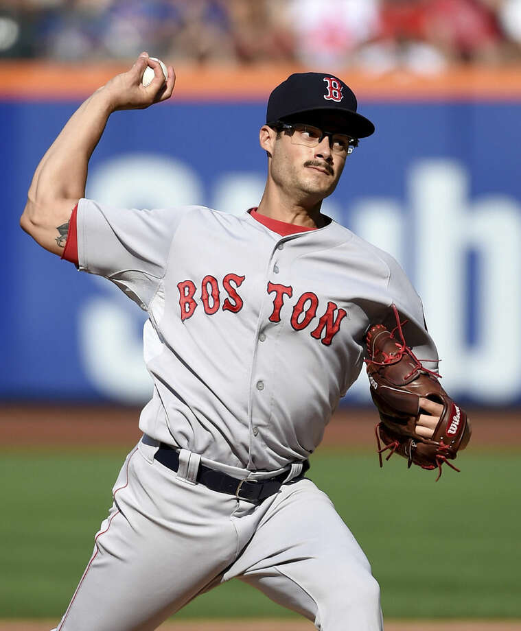 Boston Red Sox starter Joe Kelly pitches against the New York Mets in the first inning of a baseball game at Citi Field on Saturday, Aug. 29, 2015, in New York. (AP Photo/Kathy Kmonicek)