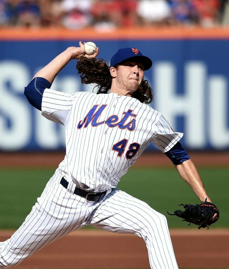New York Mets starter Jacob deGrom (48) pitches against the Boston Red Sox in the first inning of a baseball game at Citi Field on Saturday, Aug. 29, 2015, in New York. (AP Photo/Kathy Kmonicek)