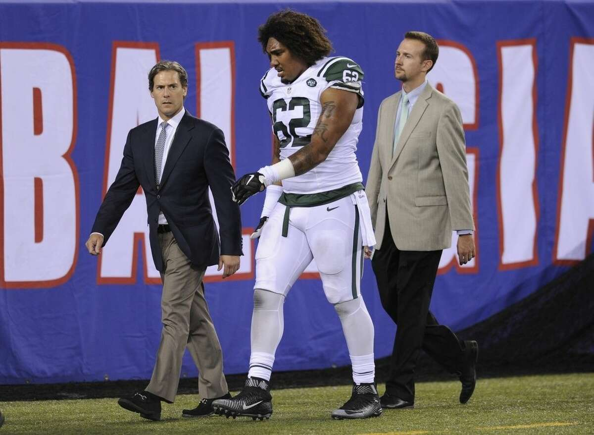 New York Jets defensive tackle Leonard Williams (62) is walked off the field during the first half of a preseason NFL football game against the New York Giants, Saturday, Aug. 29, 2015, in East Rutherford, N.J. (AP Photo/Bill Kostroun)