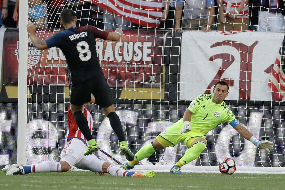 United States' Clint Dempsey, center, scores a goal past Paraguay's Justo Villar, right, and Fabian Balbuena during the first half of a Copa America Group A soccer match Saturday, June 11, 2016, in Philadelphia. (AP Photo/Matt Slocum) ORG XMIT: PXE203 Photo: Matt Slocum / Copyright 2016 The Associated Press. All rights reserved. This m