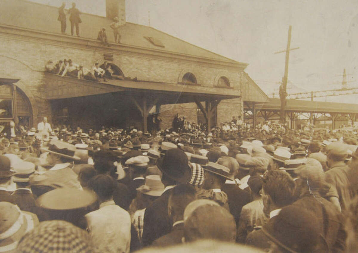 At right, photo of soldiers at the Norwalk train station being sent off to fight in World War I around 1917 from the archives of the Norwalk Public Library's history room.
