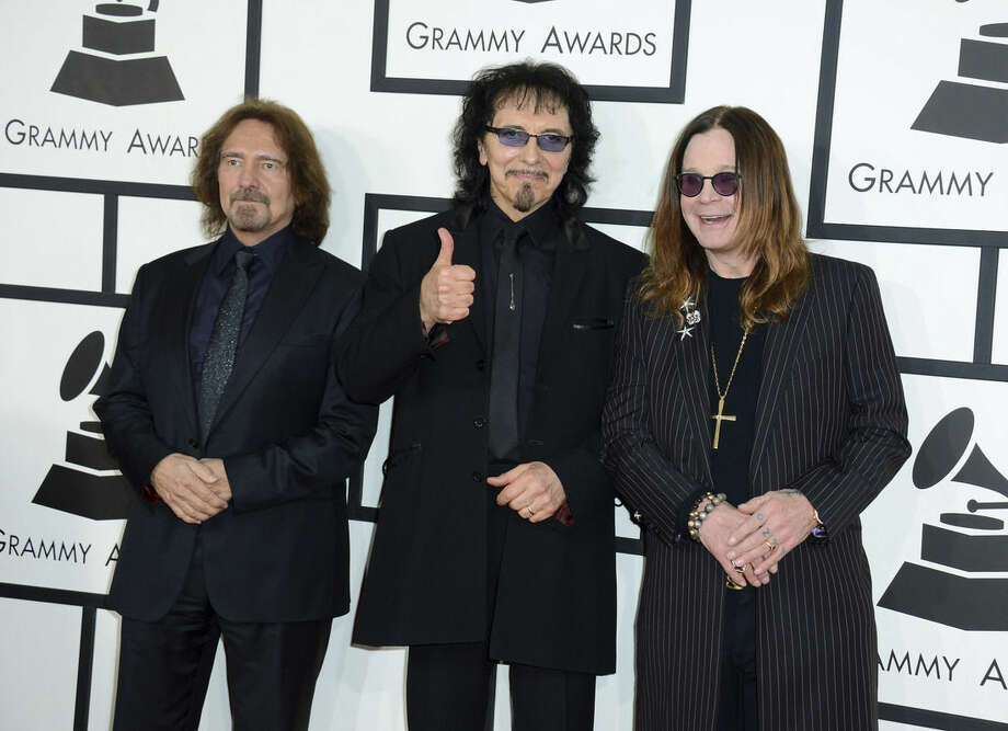FILE - In this Jan. 26, 2014 file photo, Geezer Butler, from left, Tony Iommi and Ozzy Osbourne of Black Sabbath arrive at the 56th annual Grammy Awards in Los Angeles. Black Sabbath will launch a farewell tour next year. The heavy metal band starring Ozzy Osbourne announced dates for its The End tour, which kicks off Jan. 20, 2016, in Omaha, Nebraska. (Photo by Jordan Strauss/Invision/AP, File)