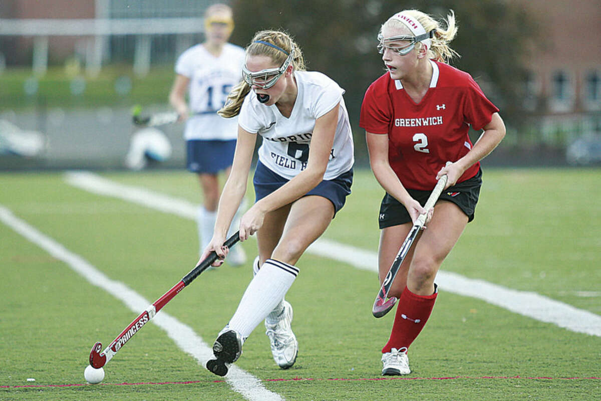 Photo by Chris Palermo Wilton's Bridget Ward keeps the the ball away from a Greenwich defender during Wilton's 2-1 double overtime win over Greenwich last season. Ward is one of the Warriors key returning players this fall.