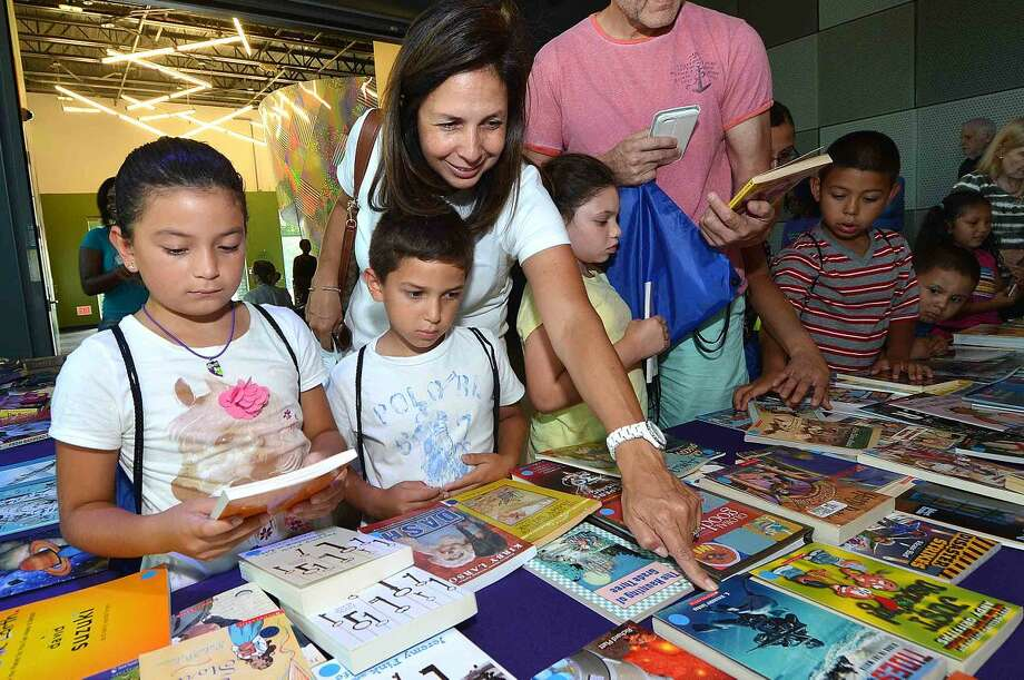 Hour Photo/Alex von Kleydorff Books handed out for free during Back to School night at Stepping Stones Museum for Children