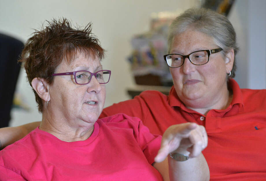 In this photo taken on Aug. 26, 2015, Karen Roberts, left, and her partner April Miller discuss their inability to obtain a marriage license in Morehead, Ky. Roberts and Miller are one of the four couples, two gay and two straight, suing Rowan County Clerk Kim Davis through the American Civil Liberties Union for refusing to issue marriage licenses due to her religious beliefs. (AP Photo/Timothy D. Easley)