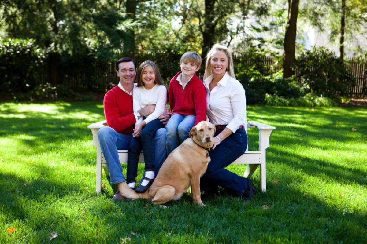 Contributed image Kristin Peck with her daughter Taylor, son Connor and husband Bob and family dog Poppy.