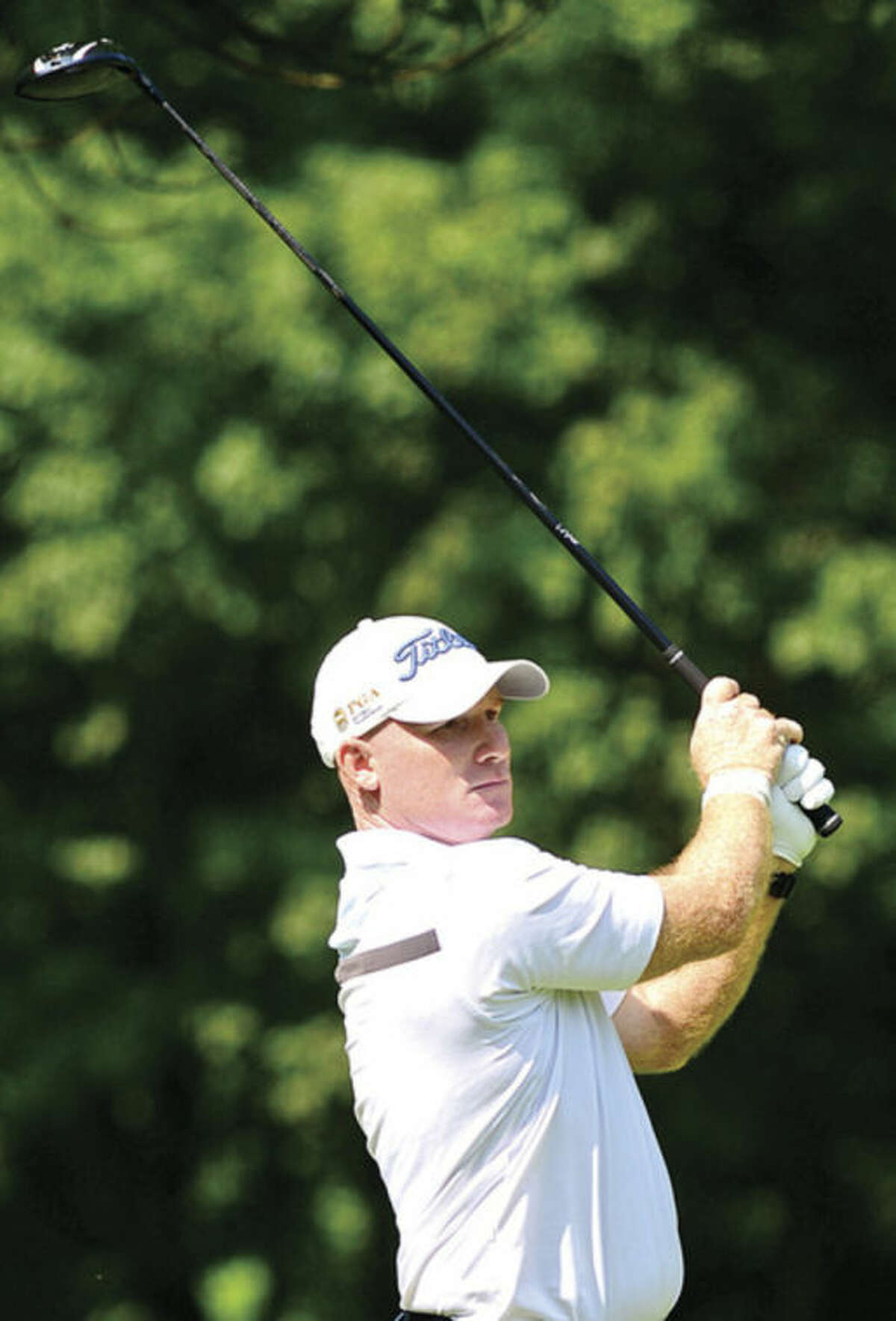 Hour photo/Erik Trautmann Frank Bensel hits off the second tee during the final round of The Connecticut Open Golf championships at Rolling Hills Country Club Wednesday in Wilton.