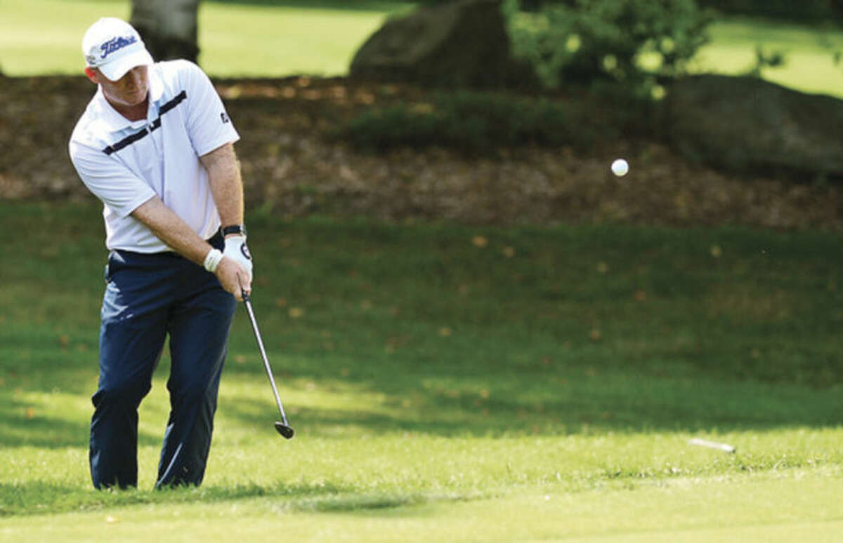 Hour photo/Erik Trautmann Frank Bensel, formerly of Norwalk, chips onto the first green during the final round of the Connecticut Open Golf Championship at Rolling Hills Country Club in Wilton Wednesday.