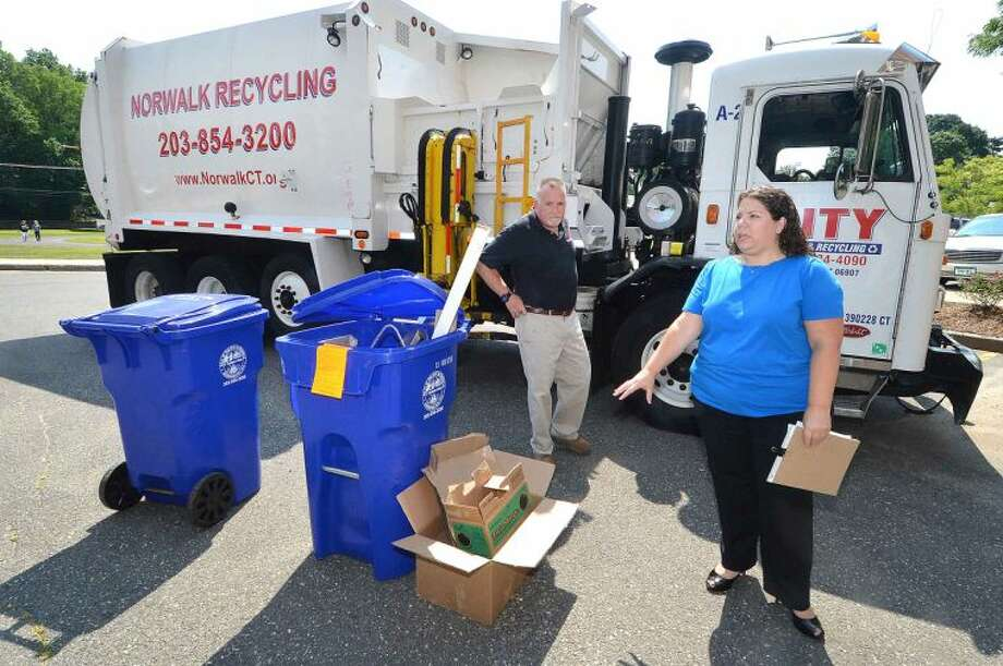 Hour Photo/Alex von Kleydorff Waste Program Manager for the City of Norwalk Jessica palladino along with Bryan Ayers, Safety Manager with City Carting, talk about the city's Recycling project
