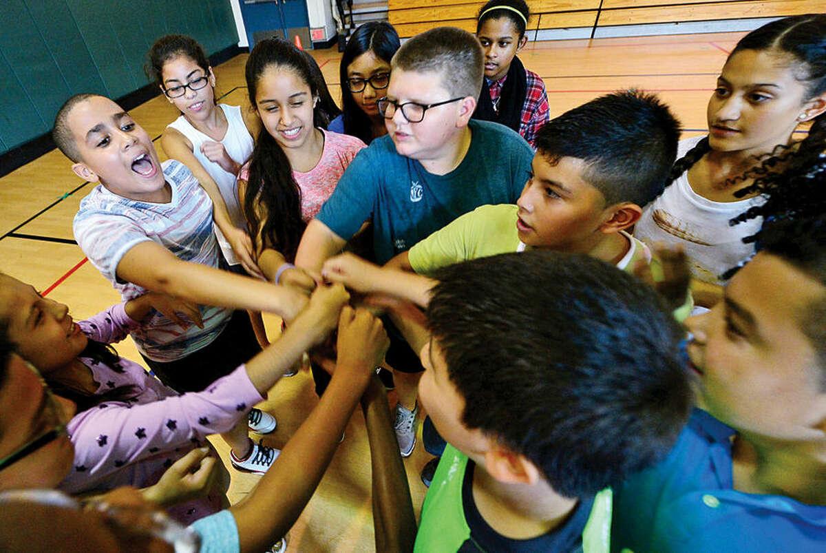 Hour photo / Erik Trautmann Ponus Ridge Middle School 7th graders take part in Positive Behavioral Intervention & Supports (PBIS) team activity, Rock, Paper, Scissors, during a school-wide PBIS Day Friday.