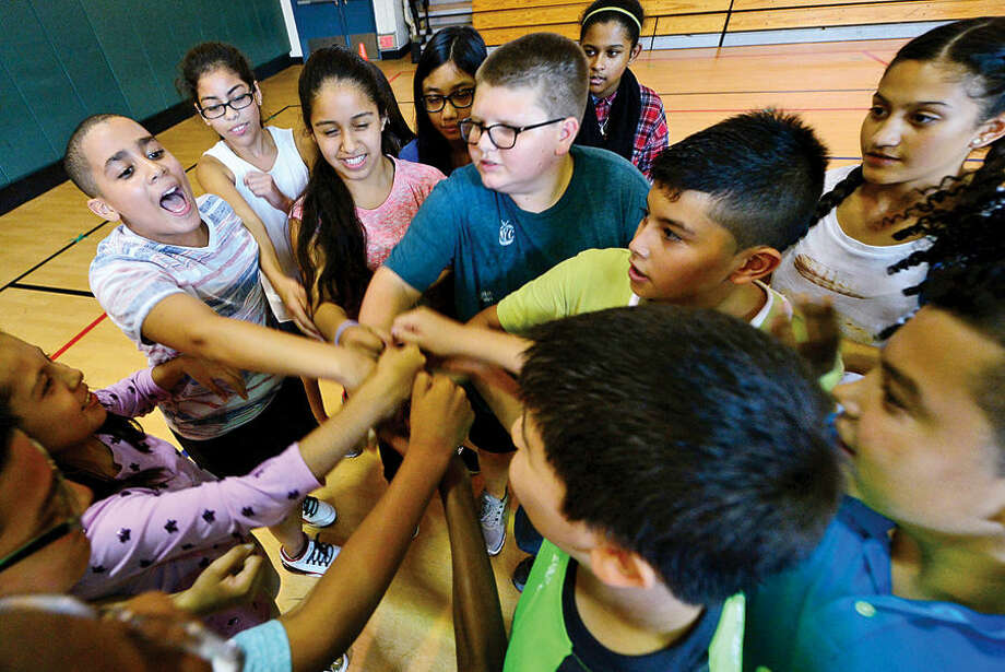 Hour photo / Erik Trautmann Ponus Ridge Middle School 7th graders take part in Positive Behavioral Intervention & Supports (PBIS) team activity, Rock, Paper, Scissors, during a school-wide PBIS Day Friday.