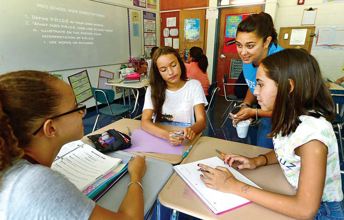 Hour photo / Erik Trautmann Ponus Ridge Middle School 8th graders take Ashley Calderon, Jazlyn Castillo and Shirley Madera take instruction from their teacher, Ashley Bonora, as part of their Positive Behavioral Intervention & Supports (PBIS) activity during a school-wide PBIS Day Friday.