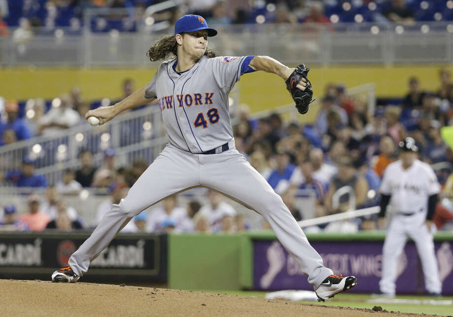 New York Mets' Jacob deGrom delivers a pitch during the first inning of a baseball game against the Miami Marlins, Friday, Sept. 4, 2015, in Miami. (AP Photo/Wilfredo Lee)