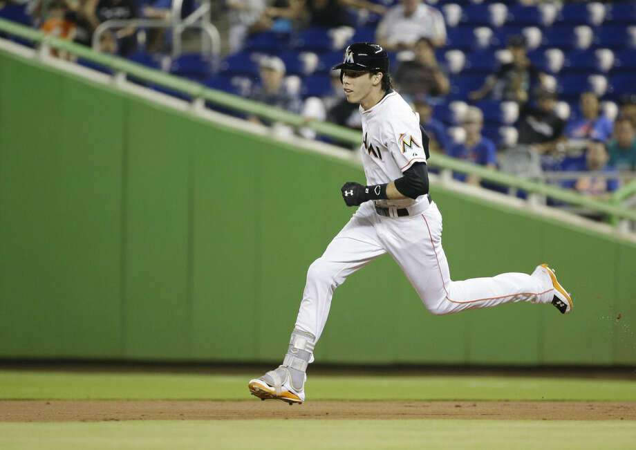 Miami Marlins' Christian Yelich runs to second base after hitting a double during the first inning of a baseball game against the New York Mets, Friday, Sept. 4, 2015, in Miami. (AP Photo/Wilfredo Lee)