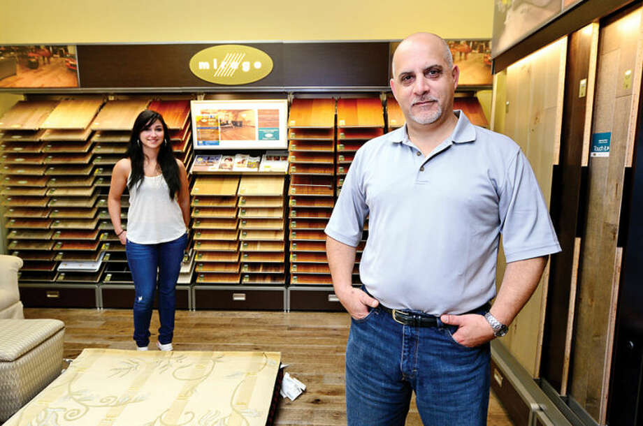 Mike Paolello, manager of Westwood Flooring & Design Center in Wilton, and sales associate Mariane Reis in the business' new showroom.