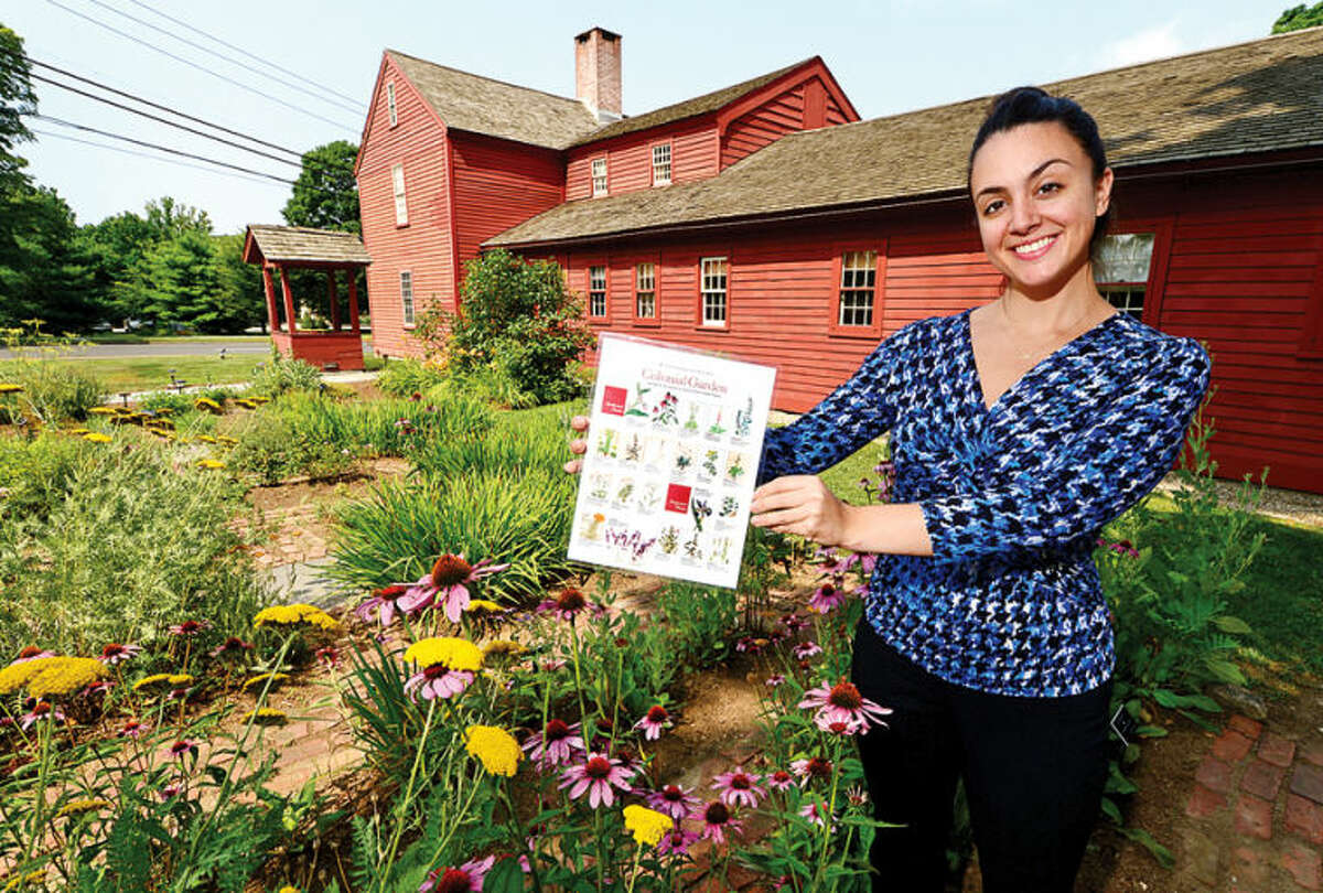 Katherine Demo, Wilton Historical Society communications and membership coordinator, shows off their 1740 Colonial Herb Garden.
