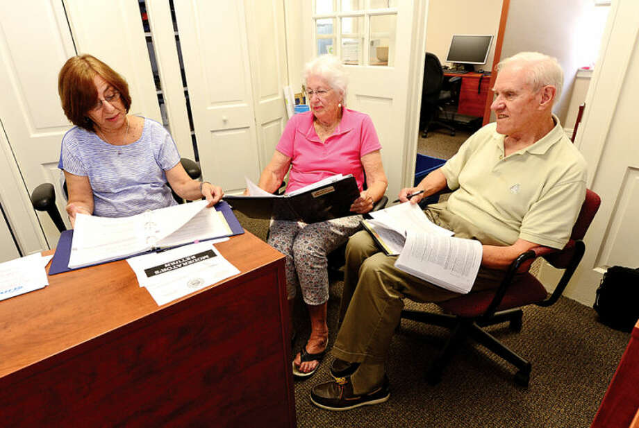 Wilton Republican Registrar of Voters Tina Gardner instructs moderators Joan Starr and Tim Dineen for the upcoming Republican primary set for Aug. 12
