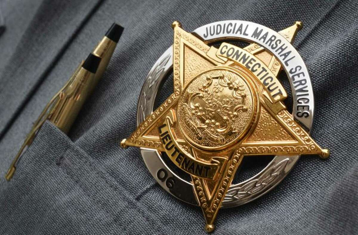 Hour Photo/Alex von Kleydorff The Badge, #06 of Lt. Richard Rilling is new with the uniforms of the Judicial Marshal's at The Norwalk Superior Courthouse