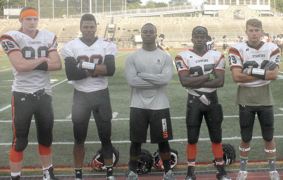 Photo by Joe RyanStamford football captains, from left, Ryan Holbrook, Omar Fortt, Chris Desir, Tyequan Bonaparte and George Nikolopoulos.