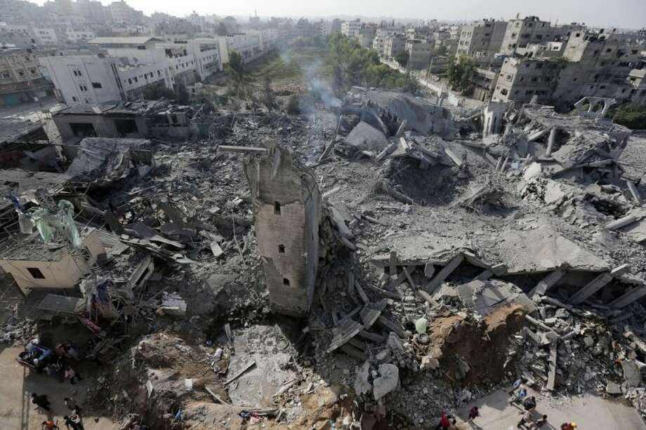 Smoke billows from the rubble of the Imam Al Shafaey mosque, destroyed in an overnight Israeli strike in Gaza City in the northern Gaza Strip on Saturday, Aug. 2, 2014. (AP Photo/Lefteris Pitarakis)