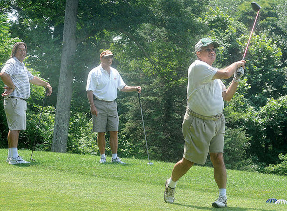 AlDivito class if 1965 tees off Monday afternoon, along with Fred DeFinis class of 1967 and Tony Agostino class of 1980 at the Brien McMahon Alumni Association's 10th annual golf tournament at Oak Hills Golf Course. Hour photo/Matthew Vinci