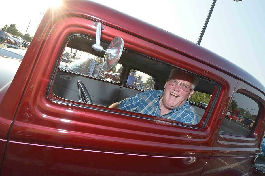Hour Photo/Alex von Kleydorff Gary Svendsen backs up his 1932 Victoria Custom into a spot for the year's final vintage car show and First County Bank Concert, at Calf Pasture Beach with The Coachmen Rod and Custom Club and a gathering of more than 100 classic vehicles and a concert by Keith Marron's Whistleville Band