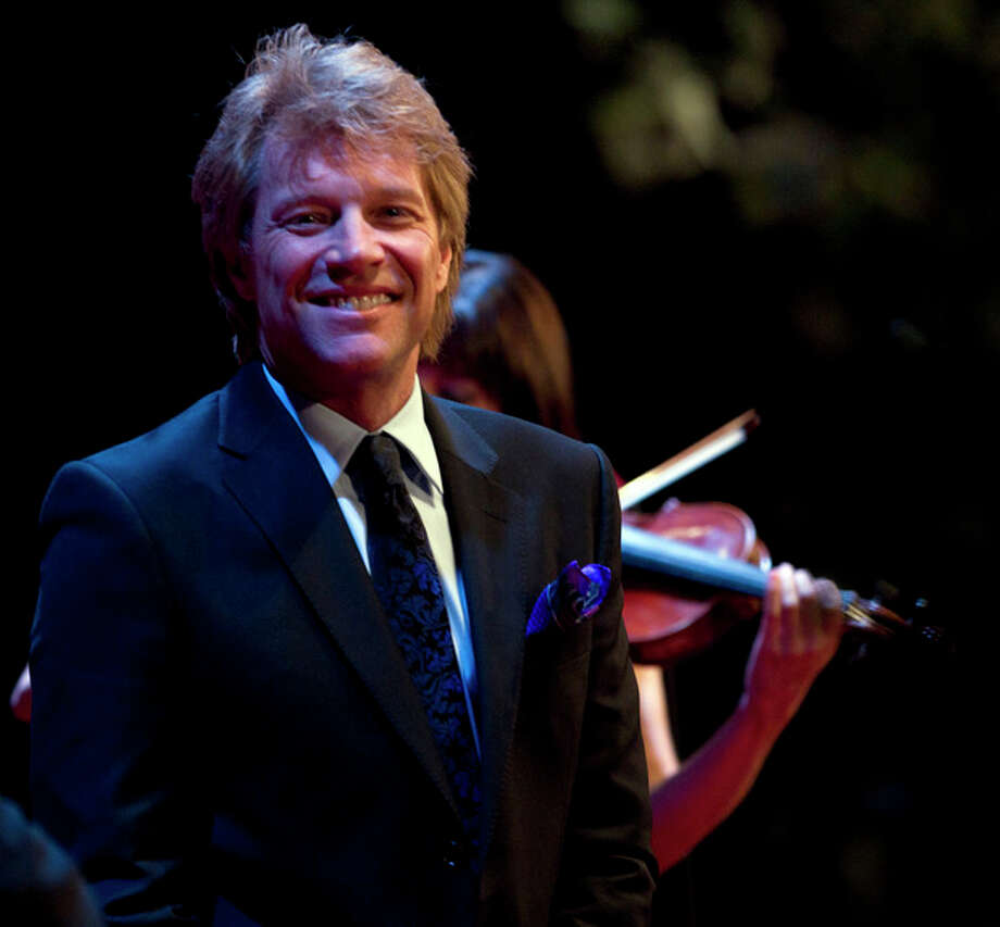 FILE - Musician Jon Bon Jovi performs at a campaign event for President Barack Obama at the Waldorf Astoria, in this June 4, 2012 file photo taken in New York. Bon Jovi is slated to be on hand when Gov. Chris Christie signs New Jersey's drug overdose prevention bill into law Thursday May 2, 2013. (AP Photo/Carolyn Kaster, File) / AP