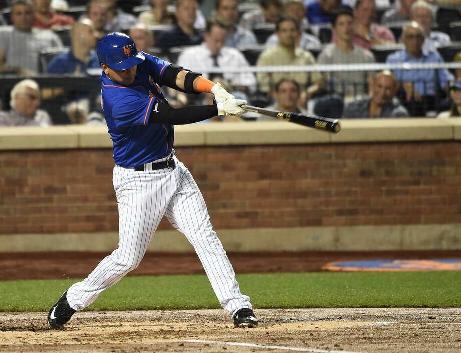 New York Mets' Ruben Tejada hits a two-run inside the park home run off of Philadelphia Phillies starting pitcher Aaron Nola in the second inning of a baseball game on Wednesday, Sept. 2, 2015, in New York. (AP Photo/Kathy Kmonicek)