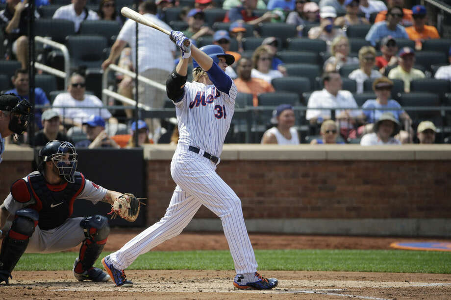 New York Mets' Noah Syndergaard, right, hits a second-inning RBI-single in an interleague baseball game against the Boston Red Sox in New York, Sunday, Aug. 30, 2015. (AP Photo/Kathy Willens)