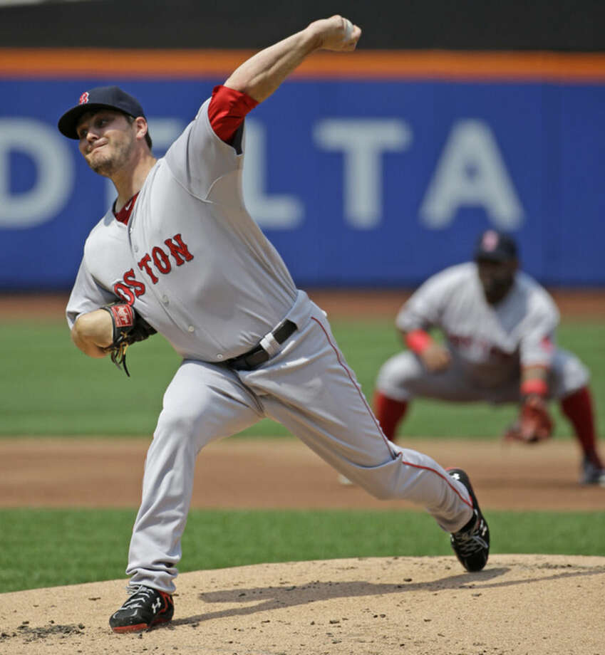 Boston Red Sox starting pitcher Wade Miley delivers in the first inning of an interleague baseball game against the New York Mets in New York, Sunday, Aug. 30, 2015. (AP Photo/Kathy Willens)
