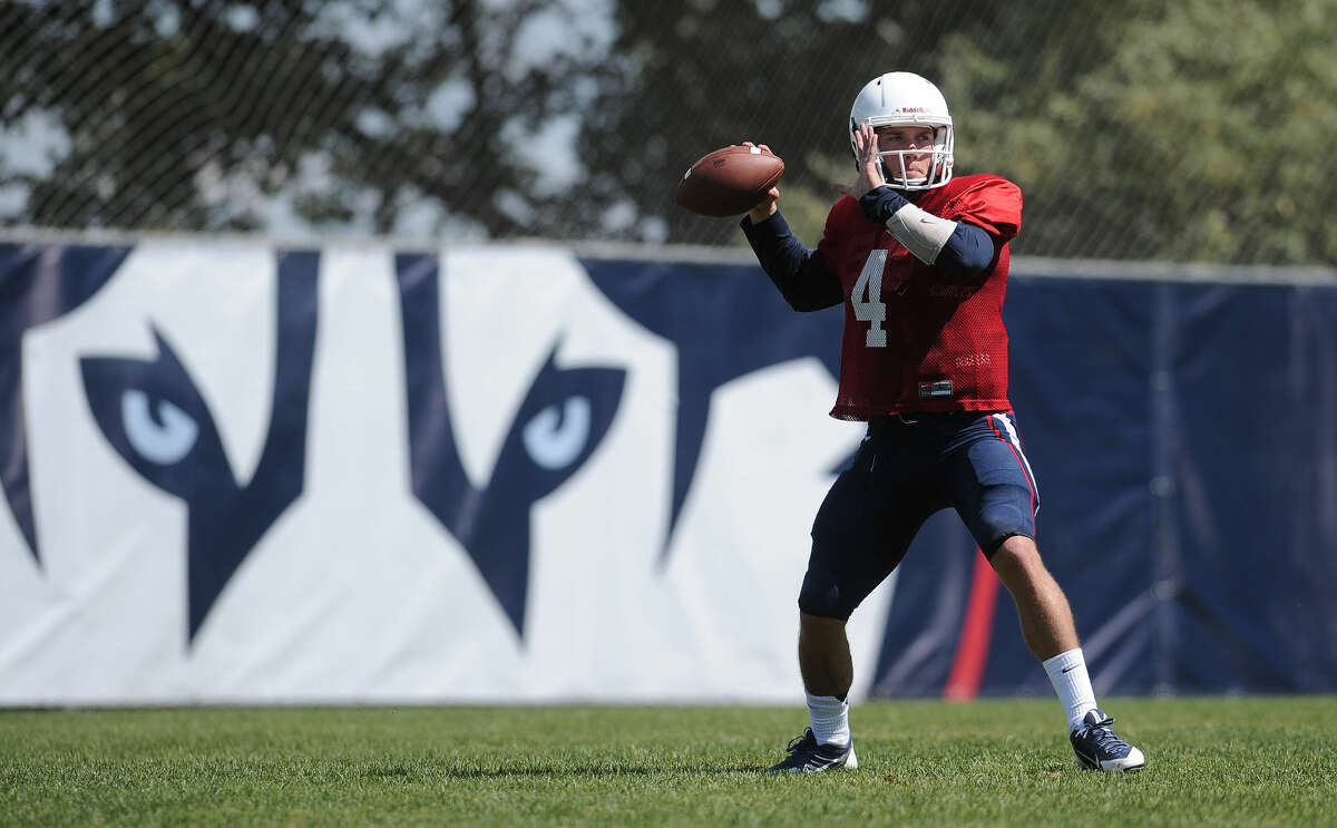 Connecticut quarterback Bryant Shirreffs throws during an NCAA college football practice, Wednesday, Aug. 12, 2015, in Storrs, Conn. (AP Photo/Jessica Hill)
