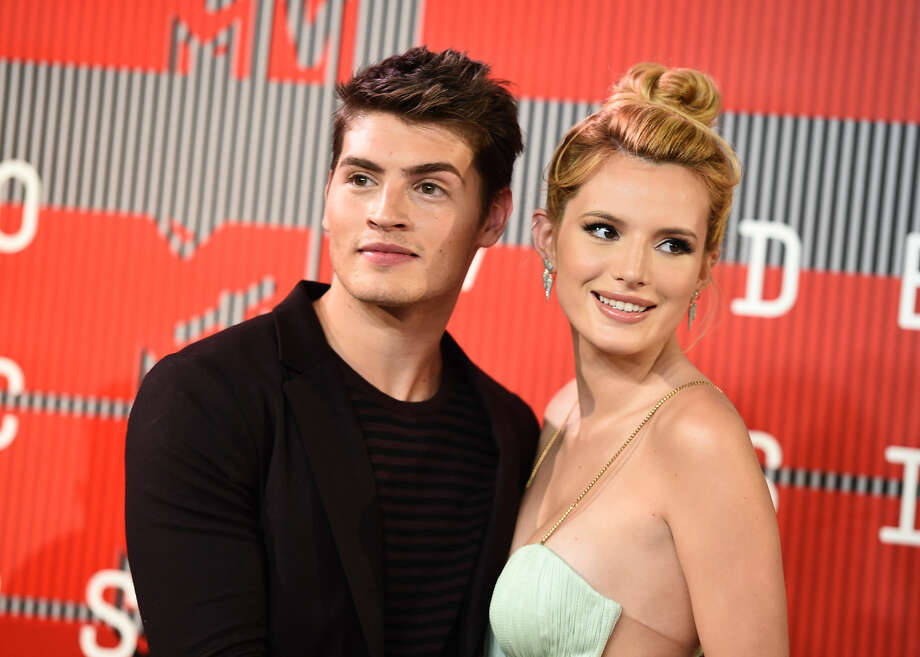 Gregg Sulkin, left, and Bella Thorne arrive at the MTV Video Music Awards at the Microsoft Theater on Sunday, Aug. 30, 2015, in Los Angeles. (Photo by Jordan Strauss/Invision/AP)