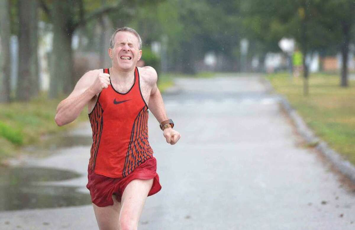 Hour Photo/Alex von Kleydorff. 53 yr old Paul Greenburg makes it to the finish line 6th