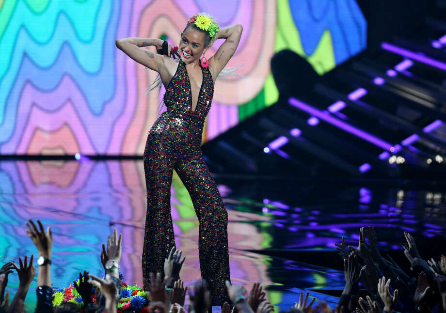 Host Miley Cyrus appears at the MTV Video Music Awards at the Microsoft Theater on Sunday, Aug. 30, 2015, in Los Angeles. (Photo by Matt Sayles/Invision/AP)