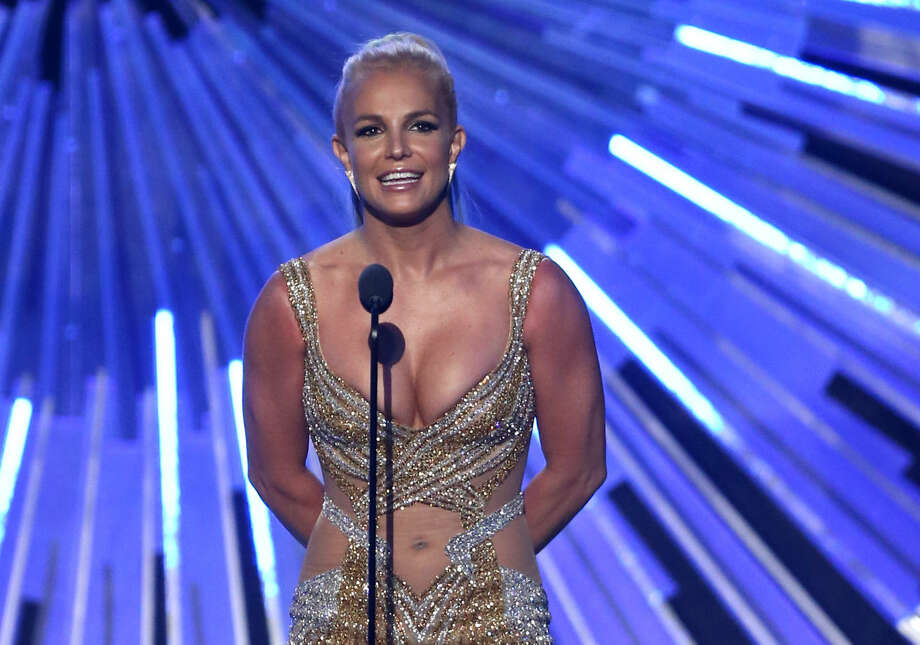 Britney Spears presents the award for male video of the year at the MTV Video Music Awards at the Microsoft Theater on Sunday, Aug. 30, 2015, in Los Angeles. (Photo by Matt Sayles/Invision/AP)