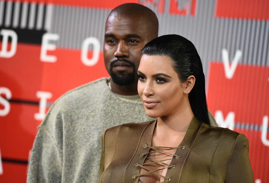 Kanye West, left, and Kim Kardashian arrive at the MTV Video Music Awards at the Microsoft Theater on Sunday, Aug. 30, 2015, in Los Angeles. (Photo by Jordan Strauss/Invision/AP)