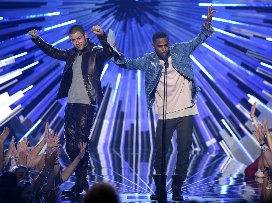 Nick Jonas, left, and Big Sean present the award for female video of the year at the MTV Video Music Awards at the Microsoft Theater on Sunday, Aug. 30, 2015, in Los Angeles. (Photo by Matt Sayles/Invision/AP)