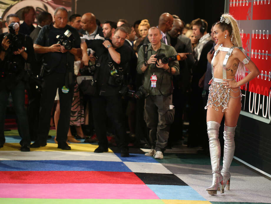 Miley Cyrus arrives at the MTV Video Music Awards at the Microsoft Theater on Sunday, Aug. 30, 2015, in Los Angeles. (Photo by Matt Sayles/Invision/AP)