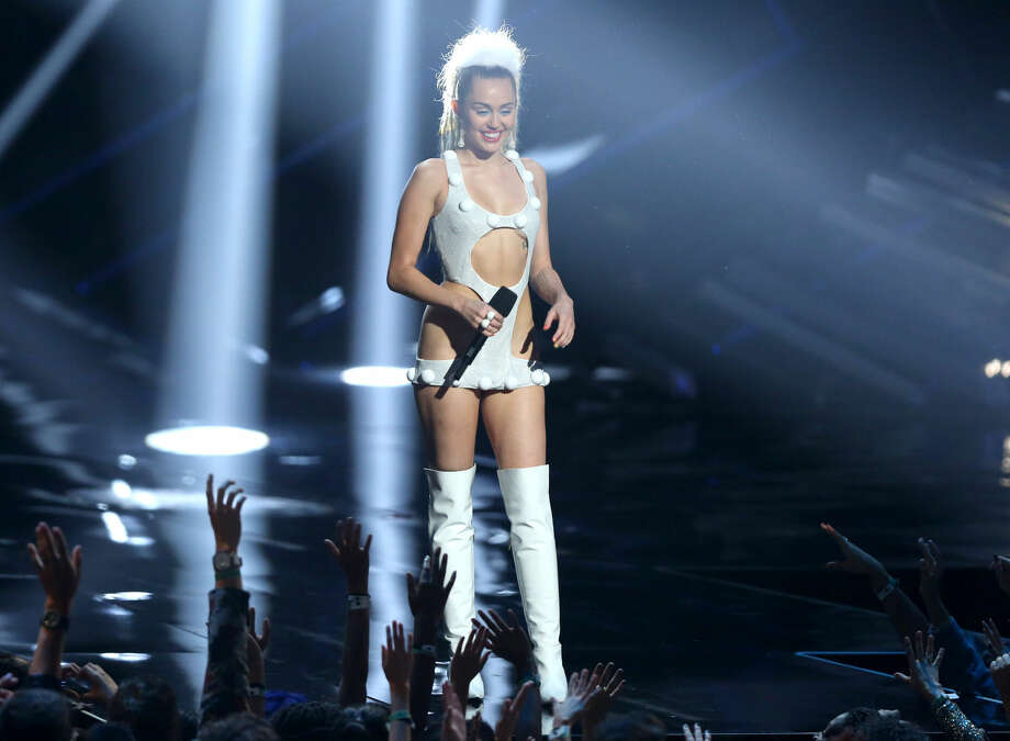 Miley Cyrus appears at the MTV Video Music Awards at the Microsoft Theater on Sunday, Aug. 30, 2015, in Los Angeles. (Photo by Matt Sayles/Invision/AP)