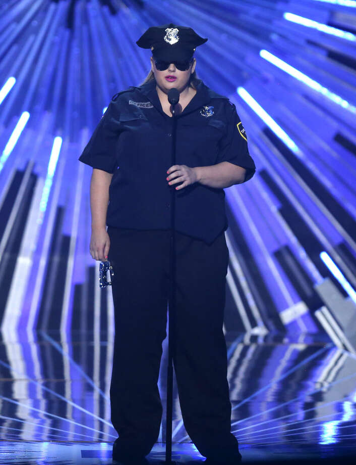 Rebel Wilson presents the award for hip-hop video of the year at the MTV Video Music Awards at the Microsoft Theater on Sunday, Aug. 30, 2015, in Los Angeles. (Photo by Matt Sayles/Invision/AP)