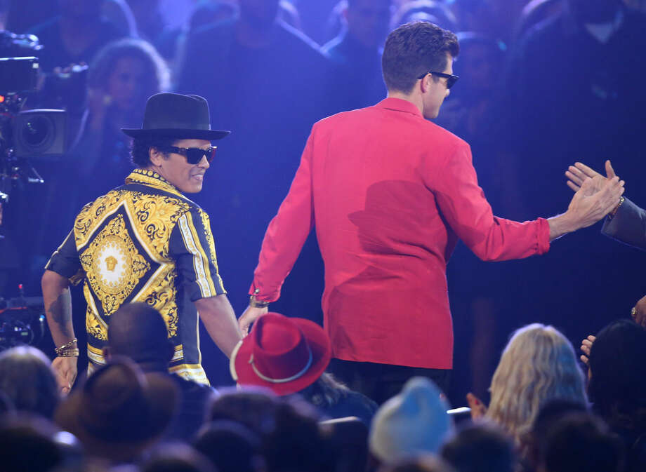 """Bruno Mars, left, and Mark Ronson walk to the stage to accept the award for male video of the year for """"Uptown Funk"""" at the MTV Video Music Awards at the Microsoft Theater on Sunday, Aug. 30, 2015, in Los Angeles. (Photo by Matt Sayles/Invision/AP)"""