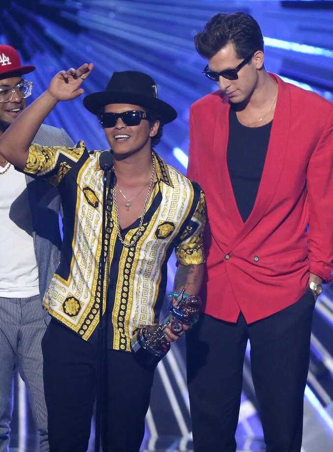 """Bruno Mars, left, and Mark Ronson accept the award for male video of the year for """"Uptown Funk"""" at the MTV Video Music Awards at the Microsoft Theater on Sunday, Aug. 30, 2015, in Los Angeles. (Photo by Matt Sayles/Invision/AP)"""