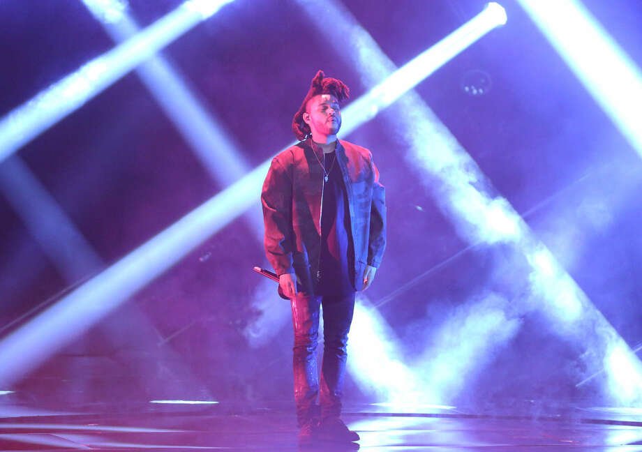The Weeknd performs at the MTV Video Music Awards at the Microsoft Theater on Sunday, Aug. 30, 2015, in Los Angeles. (Photo by Matt Sayles/Invision/AP)