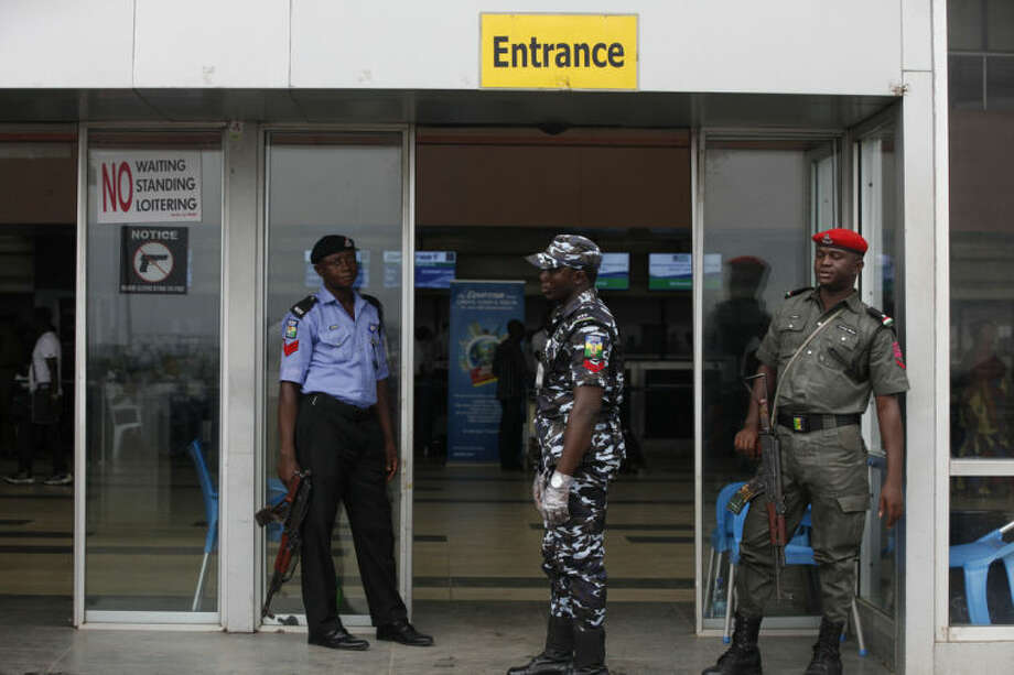 Police officers stand guard at the departure hall of Murtala Muhammed International Airport in Lagos, Nigeria, Monday, Aug. 4, 2014. Nigerian authorities on Monday confirmed a second case of Ebola in Africa's most populous country, an alarming setback as officials across the region battle to stop the spread of a disease that has killed more than 700 people. (AP Photo/Sunday Alamba)
