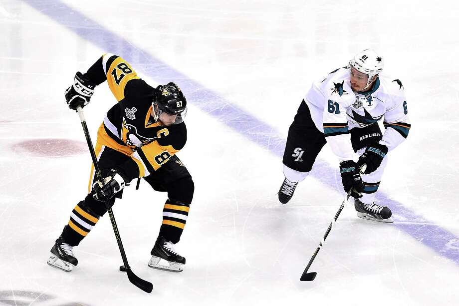 PITTSBURGH, PA - JUNE 09: Sidney Crosby #87 of the Pittsburgh Penguins is defended by Justin Braun #61 of the San Jose Sharks during the first period in Game Five of the 2016 NHL Stanley Cup Final at Consol Energy Center on June 9, 2016 in Pittsburgh, Pennsylvania. The San Jose Sharks defeated the Pittsburgh Penguins 4-2. (Photo by Jamie Sabau/Getty Images) ORG XMIT: 643396957 Photo: Jamie Sabau / 2016 Getty Images
